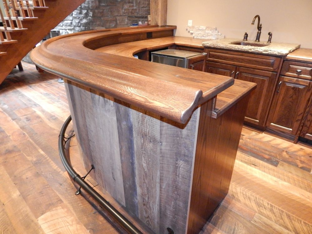Curved Custom Bar With Bronze Foot Rail Accents